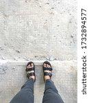 Top View Feet Wearing Sandals...