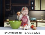 little toddler cooking in the...