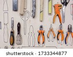 Carpenter tools pliers mallet hammer ruler scissors hang on board at the furniture production. Concept of accuracy in work and own small production. Woodworking concept - stock photo