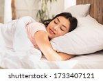 Asian Woman Sleeping Lying In...