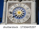 Clock tower in freedom square, watch closeup, Udine, Italy
