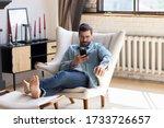 Millennial Caucasian Man Sit...