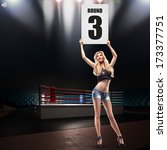 Small photo of Boxing ring girl holding a board. High resolution