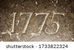"""""""1775"""" carved in stone – a detail of an inscription produced that year"""