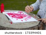 little girl drawing red heart.... | Shutterstock . vector #173394401