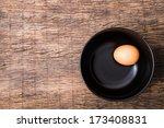 an egg in the black bowl on... | Shutterstock . vector #173408831