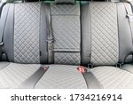 Car covers made of eco leather. An article about the upholstery of seats in a car. Premium cases. Premium car design. Rich car finish. Gray eco leather covers. - stock photo