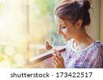 woman touching a butterfly | Shutterstock . vector #173422517