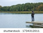 Young Man Standing Alone On...