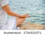 woman meditating at the sea   Shutterstock . vector #1734331571