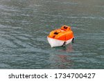 Maneuvering Orange Lifeboat In...
