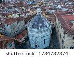 Aerial view of the Battistero di San Giovanni in corte from the tower bell of the Pistoia Cathedral, Tuscany, Italy