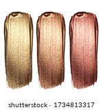 Small photo of Creative brushstrokes of gold paint isolated on a white background. Gold paint texture.Acrylic gold paint. Smears of cosmetics, blush, highlighter, eye shadow, lipstick.
