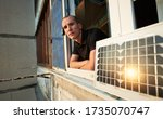 Man On Balcony Of Residential...