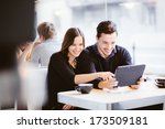 couple looking at photos on... | Shutterstock . vector #173509181