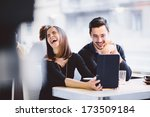 young couple looking at photos... | Shutterstock . vector #173509184