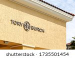 Small photo of Orlando, Florida, USA- February 24, 2020: Tory Burch store sign on the wall above the entrance in Orlando. Tory Burch LLC is an American fashion label.
