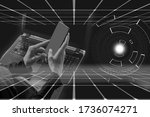 woman using laptop and phone on ...
