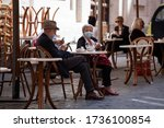 Small photo of ROME, ITALY - MAY 19 2020: Customers sit at tables in a terrace area outside cafes in Rome, Italy, on Tuesday, May 19, 2020. Shops And Restaurants Reopen As Italy Further Eases Lockdown.