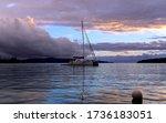 Lonely Catamaran At Sunset Nea...