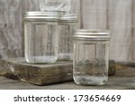 group of rustic mason jars... | Shutterstock . vector #173654669
