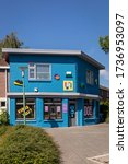 Small photo of Eindhoven, The Netherlands, May 16th 2020. Tante Netty, a creative place with a colorful bright blue facade in a street downtown in Eindhoven. Vertical shot on a sunny day during spring