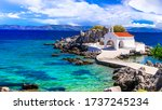 Small photo of Authentic traditional Greek islands- unspoiled Chios, View of little church in the sea over the rocks , Agios Isidoros