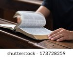 man reading bible in the church. | Shutterstock . vector #173728259