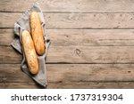 Fresh Baguette Bread On Wooden...
