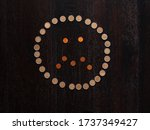 Small photo of Coin confounded smile. Confounded face done by coins. Money icon.