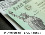 Small photo of Extreme close-up of Federal coronavirus stimulus check provided to all Americans from the United States Treasury in 2020 and 2021, showing the statue of liberty.