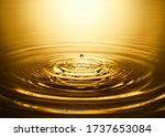 Golden Water Ripple And Water...