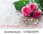 three roses and heart shapes for valentines day with german text 14. Februar Valentinstag - stock photo