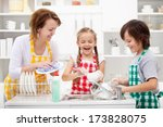 kids and mother washing dishes  ... | Shutterstock . vector #173828075