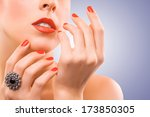 face and beautiful red manicure | Shutterstock . vector #173850305