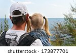 father holding his young... | Shutterstock . vector #173877701