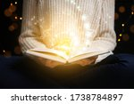 Young Woman Holding Open Book...