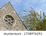 A Small Stone Building With A...