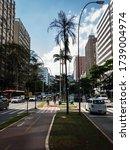 Small photo of SAO PAULO / BRAZIL - DEC 5, 2018: Bike lanes running on the median strip of Brigadeiro Faria Lima avenue with rush hour traffic on both ways of the avenue near Gabriel Monteiro da Silva alameda.