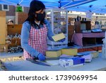 A Shop Clerk Wearing Protective ...