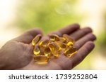 A Handful Of Vitamin D Capsule...