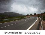 a winding  road through hills....