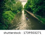 two canoeists are sailing on the river