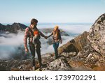 Family hiking man and woman traveling with baby carrier outdoor healthy lifestyle vacations in mountains mother and father holding hands eco tourism summer activity