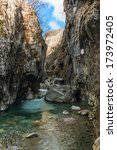 Small photo of Rapids in DovÃ?anova soteska gorge with a road tunnel carved in the rock, Slovenia