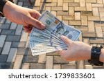 A Man Holds Dollar Banknote In...