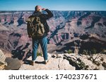 Back View Of Male Hiker With...