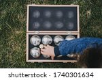 Kid Grabbing Boules Out Of A...