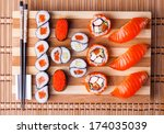 sushi and rolls on a bamboo geta | Shutterstock . vector #174035039