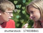 happy young couple talking.... | Shutterstock . vector #174038861